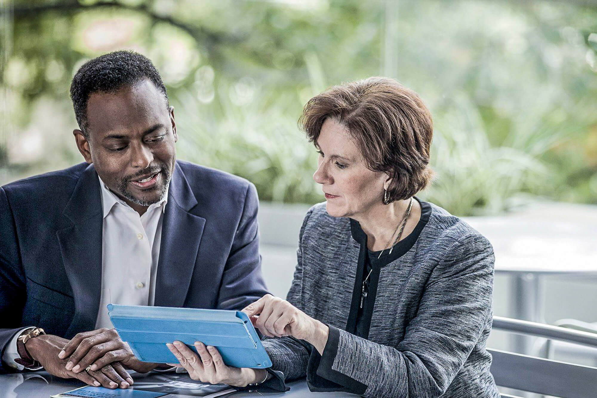 Man and Woman discussing over mobile device